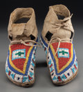 American Indian Art:Beadwork and Quillwork, A Pair of Plains Beaded Buffalo Hide Moccasins. c. 1910... (Total:2 Items)