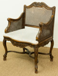 Furniture , A French Provincial-Style Carved Oak, Caned, and Upholstered Bergère, early 20th century. 39-3/4 h x 28-1/2 w x 21-1/2 d inc...