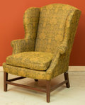 Furniture, A Georgian-Style Upholstered Mahogany Wingback Armchair. 46 h x 32 w x 27-1/2 d inches (116.8 x 81.3 x 69.9 cm). ...