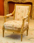 Furniture , A Louis XVI-Style Giltwood and Upholstered Fauteuil, 20th century. 40-1/2 h x 29 w x 24-1/2 d inches (102.9 x 73.7 x 62.2 cm...