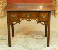 A Chippendale-Style Oak Dressing Table, late 18th century 28 h x 34 w x 19-1/2 d inches (71.1 x 86.4 x 49.5 cm)