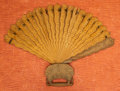 Asian, A Southeastern Asian Carved Wood Fan. 15 inches long (38.1 cm). ...