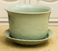 Asian, A Group of Nine Chinese Celadon Glazed Planters and Plates. Marks:(character marks to underside of two underplates). 6-5/8 ...(Total: 9 Items)