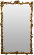 Furniture, A Large Louis XV-Style Giltwood Mirror. 84 h x 52 w x 4 d inches (213.4 x 132.1 x 10.2 cm). ...