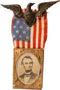 Political:Ferrotypes / Photo Badges (pre-1896), Abraham Lincoln: Gem Albumen Badge with Eagle Hanger....