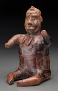 Pre-Columbian:Ceramics, A Seated Colima Warrior with Incised Designs. c. 200 BC - 100 AD...
