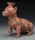 Pre-Columbian:Ceramics, A Colima Seated Dog . c. 200 BC - 100 AD...