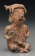 Pre-Columbian:Ceramics, A Nayarit Figure with Flayed Dog. c. 200 BC - 200 AD...