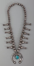 American Indian Art:Jewelry and Silverwork, A Navajo Squash Blossom Necklace. c. 1910...