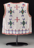 American Indian Art:Beadwork and Quillwork, A Sioux Pictorial Beaded Hide Vest. c. 1900... (Total: 2 Items)