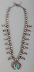 American Indian Art:Jewelry and Silverwork, A Navajo/Pueblo Squash Blossom Necklace . c. 1925...