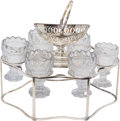 Silver Holloware, Continental, An English George III-Style Silver-Plated Egg Cruet Set, 20thcentury. 8-1/8 inches high (20.6 cm) (frame, basket handle ext...