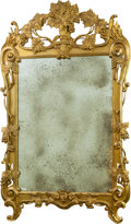 Decorative Arts, Continental, A Baroque-Style Carved Giltwood Mirror with Grape Motif, late 19thcentury. 66 x 42-1/2 inches (167.6 x 108.0 cm). ...