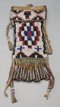 American Indian Art:Beadwork and Quillwork, An Apache Beaded Buffalo Hide Strike-A-Light Pouch. c. 1910...