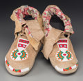 American Indian Art:Beadwork and Quillwork, A Pair of Blackfoot Beaded Hide Moccasins... (Total: 2 Items)