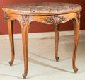 Furniture , A Louis XIV-Style Carved Walnut and Marble Center Table, early 20th century. 32 inches high x 39 inches diameter (81.3 x 99....