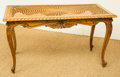 Furniture , A French Provincial-Style Carved Oak and Caned Coffee Table, 20th century. 22 h x 39 w x 19-3/4 d inches (55.9 x 99.1 x 50.2...