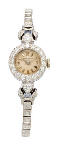 Estate Jewelry:Watches, Movado Lady's Diamond, White Gold Watch. ...