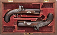Cased Pair of Engraved Percussion Derringers