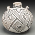 American Indian Art:Pottery, An Anasazi Black-On-White Canteen . c. 1000 - 1200 AD...