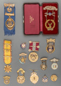 Silver Smalls, A Group of Fourteen 14K, 10K Gold, Gilt and Enameled FraternalMembership Badges, 20th century. 3-3/4 inches long (9.5 cm) (...(Total: 14 Items)