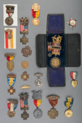 Sculpture, A Group of Eighteen Spanish-American War Buttons and Badges, circa 1898-1930. 5-1/8 inches long (13.0 cm) (largest, cased ba... (Total: 18 Items)