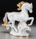 Ceramics & Porcelain, Russian, A Lomonosov Partial Gilt Porcelain Prancing Horse, 20th century.Marks: (logotype), B/C, 84. 8-3/8 inches high (21.3 cm)...