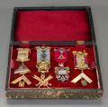 Silver Smalls, A Cased Group of Eight British 9K, 18K Gold and Sterling MasonicMedals, late 19th/early 20th century. 5-3/8 inches long (13...(Total: 8 Items)