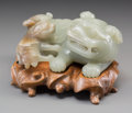 Asian, A Chinese Carved Jade Foo Lion and Cub on Wooden Stand. 3-1/8inches high x 5-3/8 inches wide (7.9 x 13.7 cm) (figure on bas...