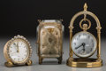 Decorative Arts, Continental, Two Gilt Metal Desk Clocks and Associated Pocket Watch Display,early-mid 20th century. 5 inches high (12.7 cm) (tallest). ...(Total: 3 Items)