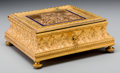 Decorative Arts, Continental, A Rococo Revival Gilt and Patinated Metal Table Casket, late 19thcentury. 3-1/4 h x 7-3/4 w x 7-3/4 d inches (8.3 x 19.7 x ...