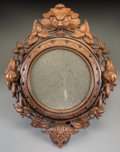 Furniture, A Renaissance Revival Carved and Ebonized Walnut Mirror, late 19th century. 23 inches high (58.4 cm). ...