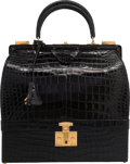 Luxury Accessories:Bags, Hermes Shiny Black Crocodile Sac Mallette Bag with Gold Hardware. Circa 1960's. Very Good to Excellent Condition. ...