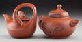 Asian:Chinese, Two Chinese Yixing Pottery Figural Teapots. Marks: (impressedcharacter marks to each) . 4 inches high (2 cm) (taller). ...(Total: 2 Items)