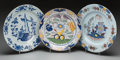 Ceramics & Porcelain, Three Dutch Delft Polychromed Chargers, 18th century. 13-1/2 inches diameter (34.3 cm) (largest). ... (Total: 3 Items)