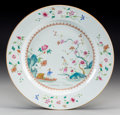 Asian:China Trade, A Chinese Export Famille Rose Porcelain Charger: Figures withinLandscape, Qianlong. 14 inches diameter (35.6 cm...