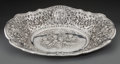 Silver Holloware, Continental, A Continental Silver Oval Bowl with Putti Motif, 20th century.Marks: JR, 925. 2-1/2 h x 14-3/4 w x 10-7/8 d inches (6.4...