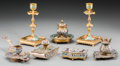 Decorative Arts, Continental, Seven Continental Gilt Bronze and Champlevé Table Articles, 20thcentury. 7 inches high (17.8 cm) (candlesticks). ... (Total: 7Items)