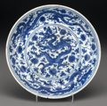 Asian:Chinese, A Rare and Important Chinese Blue and White Dragon Dish,Ming Dynasty, Zhengde Period, circa 1506-1521. Marks: F...