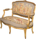 Furniture : French, A Louis XV-Style Carved and Giltwood Settee with Aubusson Upholstery, late 19th-early 20th century. 37 h x 48-1/2 w x 22-1/2...