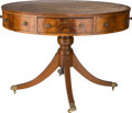 Furniture , A George III-Style Mahogany and Leather-Topped Rent Table, 20th century. 30-1/2 inches high x 42-1/2 inches diameter (77.5 x...