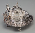 Silver Holloware, Continental, A Hanau Silver Figural Inkwell, late 19th-early 20th century.Marks: (crown-quatrefoil), A. 2-5/8 inches high (6.7 cm)....