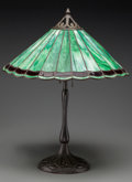 Art Glass:Other , A Handel Bronzed and Leaded Glass Table Lamp, early 20th century.Marks to base: HANDEL. 22-1/4 inches high x 18-1/8 inc...