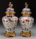 Asian:Japanese, A Pair of Imari Porcelain Covered Urns with Gilt Bronze Mountsattributed to Samson, late 19th century. 19-1/8 inches high (...(Total: 2 Items)
