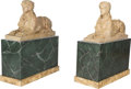 Decorative Arts, Continental, A Pair of Italian Carved Travertine Recumbent Sphinxes on FauxMarble Bases. 24-1/4 h x 12 w x 34-3/4 d inches (61.6 x 30.5 ...(Total: 4 Items)