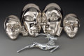Decorative Arts, Continental, Two Pairs of Art Deco Chrome Masks and an Antelope Applique, firsthalf 20th century. 8-3/4 inches high (22.2 cm) (largest, ...(Total: 5 Items)