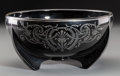Decorative Arts, Continental, An Art Deco Black Glass and Silver Foiled Centerpiece Bowl, firsthalf 20th century. 4-3/8 inches high x 8-7/8 inches diamet...