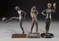 Sculpture, A Martin Schaus Bronze Victoria Figure with Two Bronze Male Sporting Figures, 20th century. Marks to female: M... (Total: 3 Items)