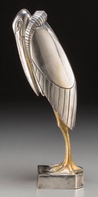 After Georges H. Laurent (French, 20th Century) Marabout Silvered and gilt bronze 14-1/2 inches (