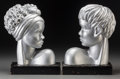 Other, A Pair of Art Deco-Style Silvered Painted Plaster Busts of a Manand Woman, 20th century. 12-3/4 x 9-1/4 x 4-1/8 inches (32....(Total: 2 Items)